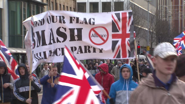 exterior shots large crowds of loyalist marchers with many carrying union flags loyalist banners walk through belfast in protest march loyalists... - northern ireland stock videos & royalty-free footage