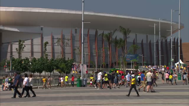 exterior shots large crowds of people walking around the barra olympic park on the final day of competition at the rio 2016 olympic games. on august... - sport venue stock videos & royalty-free footage