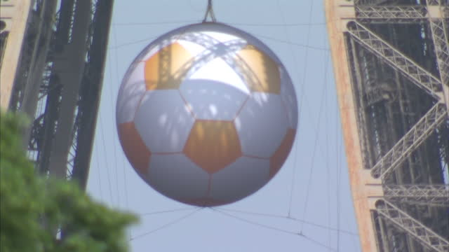 vídeos de stock, filmes e b-roll de exterior shots large euro 2016 football hanging from the eiffel tower on june 08 2016 in paris france - euro 2016