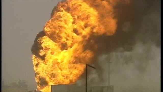 exterior shots large fire ball burning with thick black smoke drifting into the sky after oil well was destroyed, at the start of the 2003 invasion... - iraq stock videos & royalty-free footage