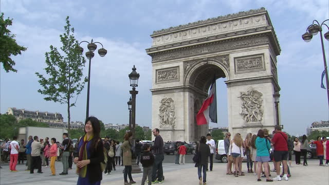 exterior shots large french flag flying from the arc de triomphe in support of the french national football team. on june 08, 2016 in paris, france. - national team stock videos & royalty-free footage