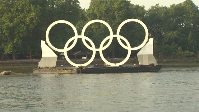 exterior shots large olympic rings positioned on float on the river thames olympic rings on the river thames on august 10 2012 in london england - olympic rings stock videos & royalty-free footage