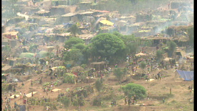 exterior shots large rwandan refugee camp at kyanza on june 16 1994 in various cities rwanda - genocide stock videos & royalty-free footage