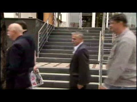 exterior shots lawyer sveta vujacic walk down pavement past armed police with radovan karadzic's brother luka karadzic & into courthouse. - radovan karadzic stock videos & royalty-free footage