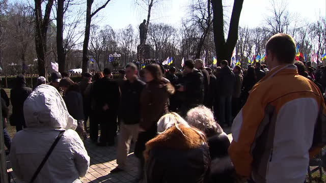 Exterior shots leader of the Svoboda party Oleh Tyahnybok making speech on stage Exterior shots people holding flags and listening to speech at...