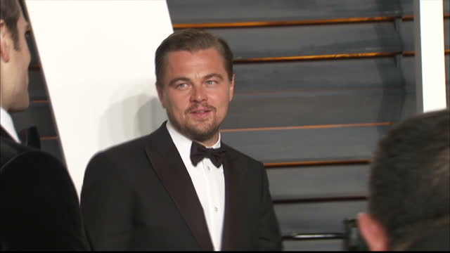 exterior shots leonardo dicaprio, actor on vanity fair red carpet with academy award for best actor waiting to pose for photographers. on february... - leonardo dicaprio stock videos & royalty-free footage