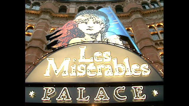 exterior shots 'les miserables' advertising material being posted outside palace theatre, london on january 23, 1989 in london, england. - sarah brightman stock videos & royalty-free footage