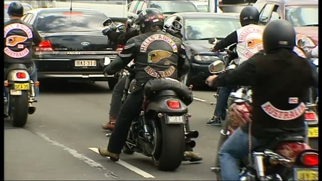 exterior shots line of hells angels bikers drive along the street. exterior shots apartment where biker shooting took place. exterior close up shot... - motorcycle biker stock videos & royalty-free footage