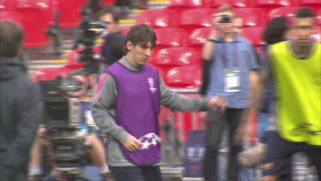 exterior shots lionel messi training with barcelona squad at wembley stadium ahead of the 2011 uefa champions league final and gets hit by football... - lionel messi stock videos and b-roll footage