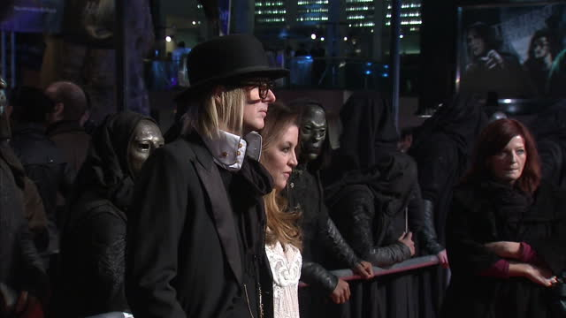 exterior shots lisa marie presley poses for the media on the red carpet at the premiere of harry potter & the deathly hallows lisa marie presley on... - lisa marie presley stock videos & royalty-free footage