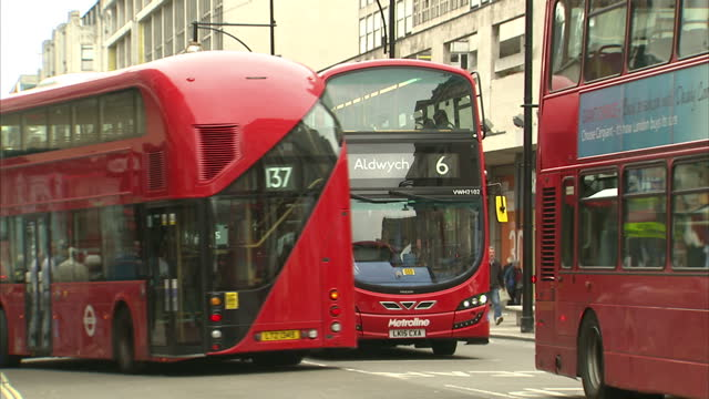 Exterior shots London buses red double decker buses travelling through Oxford Street and Regent Street junction on September 07 2015 in London England