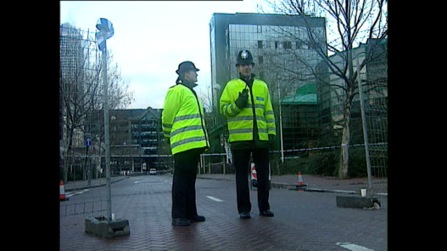 exterior shots london docklands with police cordon. - london docklands stock videos & royalty-free footage