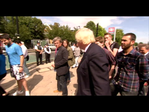 exterior shots london mayor boris johnson walks around the streets of enfield meeting chatting to local residents members of the community about the... - bürgermeister stock-videos und b-roll-filmmaterial