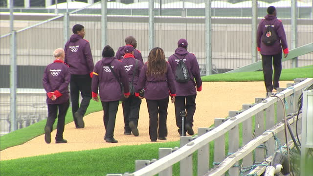 exterior shots london olympics security staff personnel walking around the olympic park area sky news 2012 olympics coverage on july 19 2012 in... - ロンドン ストラトフォード点の映像素材/bロール