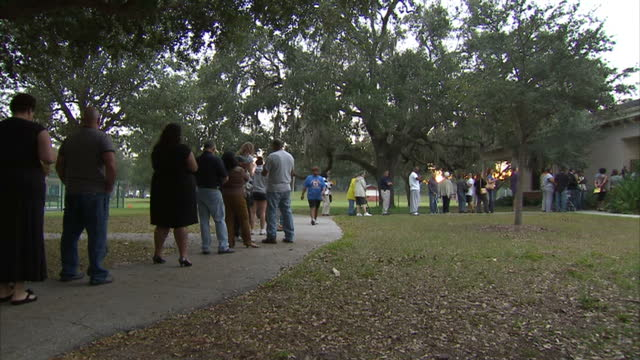 exterior shots long line of people queueing outside polling station to vote in tampa florida voters queueing on election final day at various... - gulf coast states stock-videos und b-roll-filmmaterial
