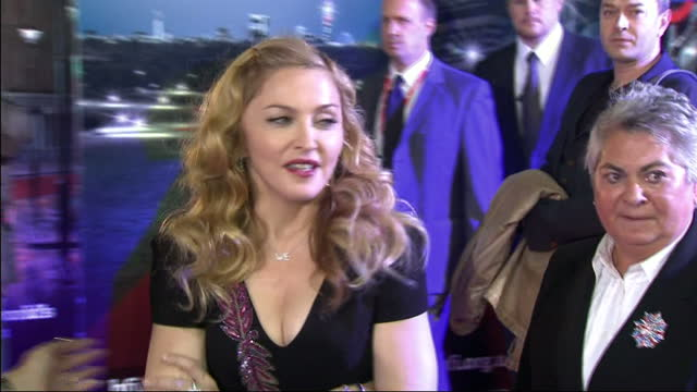 exterior shots madonna on the red carpet at the london film festival promoting her film w.e. exterior shots madonna chats to reporters madonna at the... - マドンナ点の映像素材/bロール