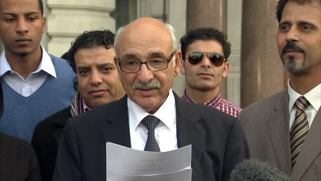 exterior shots mahmud nacua libya's charge d'affaires in london addresses the media regarding the death of colonel gaddafi libyan ambassador speaks... - muammar gaddafi stock videos & royalty-free footage