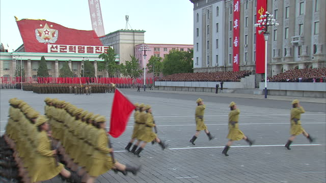 Exterior shots male and female soldiers in military uniform marching in synchronisation at Workers Party 70th Anniversary Military Parade on October...