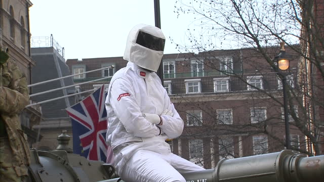exterior shots man dressed as top gear's the stig sitting on tank barrel outside bbc new broadcasting house after delivering 'bring back clarkson'... - petition stock videos & royalty-free footage