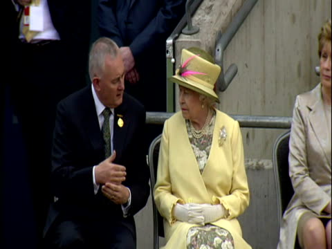 exterior shots marching band play on pitch at croke park exterior shots the queen sits chats with gaelic athletic association president christy... - the queen stock videos and b-roll footage