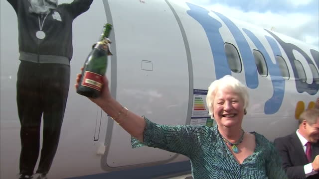 exterior shots mary peters unveils flybe plane that has been named after her. exterior shots mary peters celebrates by opening bottle of champagne &... - メアリー ピータース点の映像素材/bロール