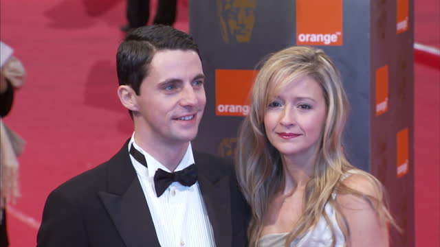 exterior shots matthew goode and sophie dymoke posing on red carpet the bafta television awards red carpet arrivals at london palladium on june 06... - matthew goode stock videos & royalty-free footage