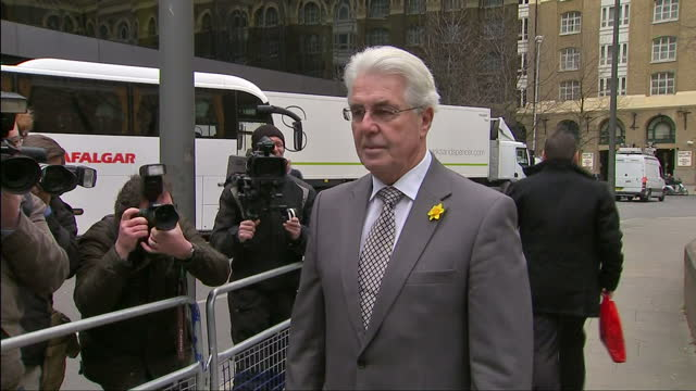 exterior shots max clifford get out of taxi pose for photographers outside southwark crown court on march 11 2014 in london england - サウスワーク刑事法院点の映像素材/bロール