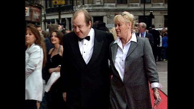 Exterior shots Mel Smith Comedian arrive with partner on August 10 1999 in London England