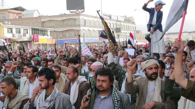 exterior shots men and boys at houthi rally , holding guns , chanting in support , people waving yemen flags , young children boys holding guns to... - 2015 stock videos & royalty-free footage