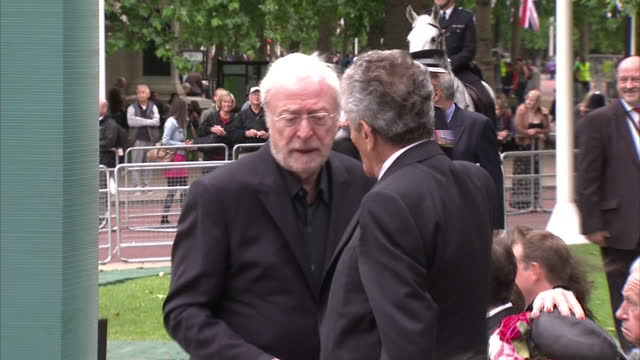 exterior shots michael caine greets guest geraldine winner michael winner's wife hugging guests stars attend michael winner memorial on june 23 2013... - michael winner stock videos & royalty-free footage