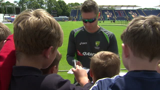 exterior shots michael clarke, australian cricket captain signing autographs at the swalec stadium during training session ahead of the first ashes... - ashes test stock videos & royalty-free footage