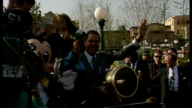 exterior shots michael eisner disney ceo arrives on car waving to crowds and media at opening of euro disney resort paris on april 11 1992 in paris... - disney stock videos and b-roll footage