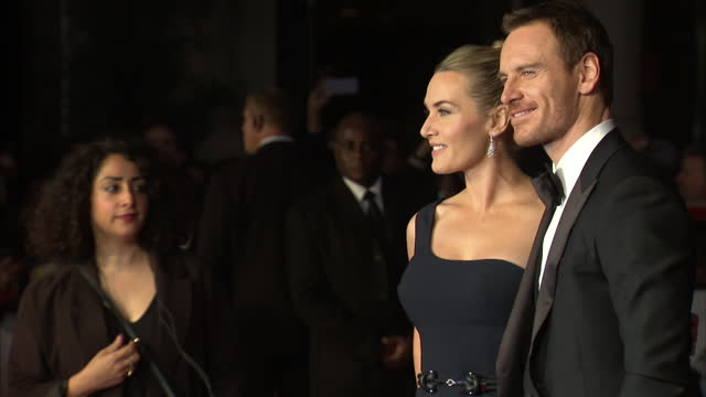 stockvideo's en b-roll-footage met exterior shots michael fassbender, actor and kate winslet, actress on red carpet at london premiere of 'steve jobs'. on october 18, 2015 in london,... - mp3 speler