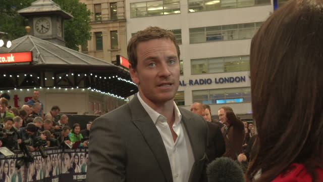 exterior shots michael fassbender speaking to journalists and hugging ridley cott at the premiere of the counselor based on an original screenplay by... - winning the first prize stock videos and b-roll footage