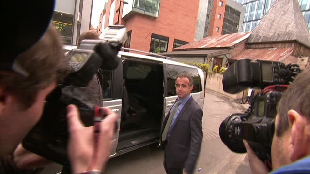 exterior shots michael le vell coronation street actor walks out of manchester crown court poses for photographers before getting into waiting car... - マイケル レ ベル点の映像素材/bロール