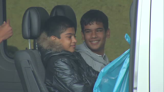 Exterior shots migrants war refugees asylum seekers young boys sitting in van at Passau temporary refugee camp in Lower Bavaria on September 03 2015...