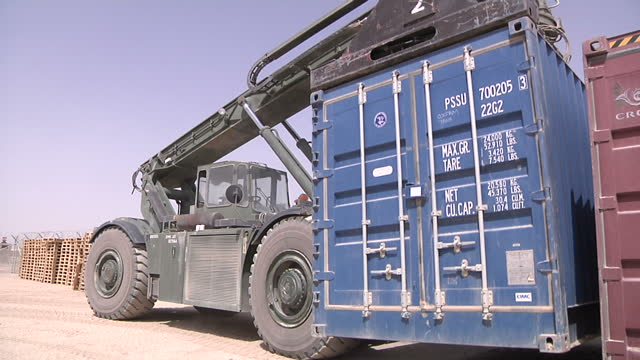 exterior shots military vehicle picking up freight container & driving to another location. freight container transportation camp bastion at camp... - film container stock videos & royalty-free footage