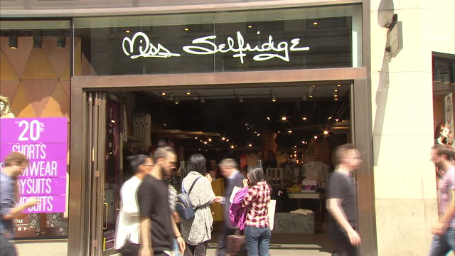 exterior shots miss selfridge store on highstreet with shoppers walking down street. on july 07, 2015 in london, england. - conservative party uk stock videos & royalty-free footage