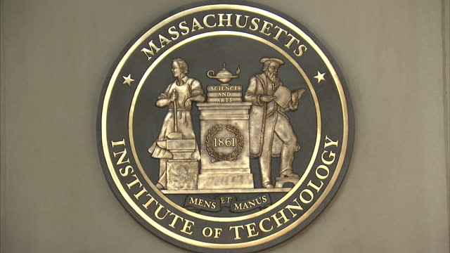 exterior shots mit massachusetts institute of technology site, campus, students and emblem on september 01, 2015 in boston, usa. - massachusetts video stock e b–roll