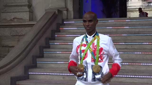 Exterior shots Mo Farah Team GB Distance Runner posing with Gold Medals won at the Rio 2016 Olympic Games in the 10000 and 5000 meter events outside...