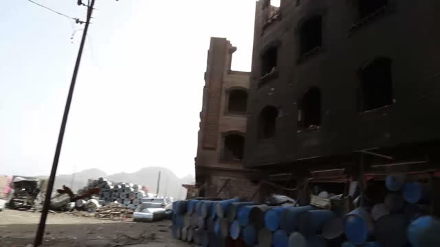 exterior shots mohamed al amari who lost family in saudi air strike looking at his burnt out house interview with mohamed al amari exterior shots... - al qaida stock videos & royalty-free footage