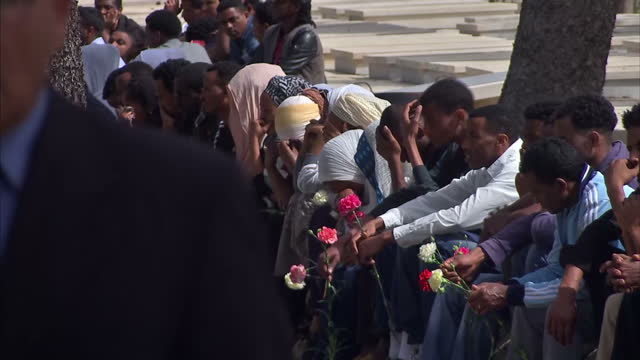 exterior shots mourners at funeral for migrants killed in boat capsizing tragedy in the mediterranean on april 23 2015 in valletta malta - capsizing stock videos and b-roll footage
