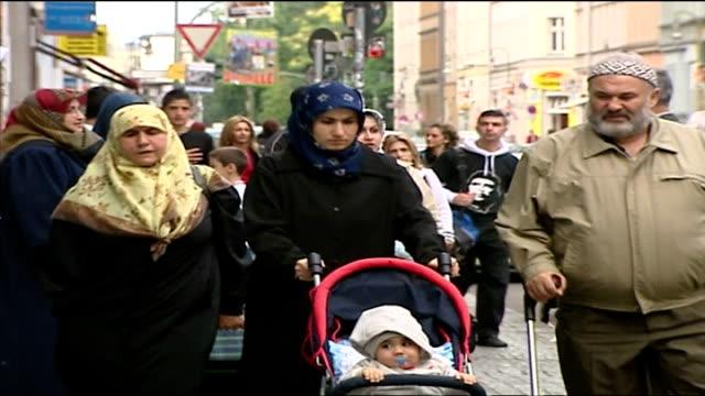 Exterior shots Muslim people ethnic minorities families with children in streets of Berlin on September 29 2005 in Berlin Germany