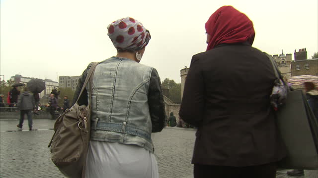 LONDON exterior shots Muslim woman wearing Poppy Hijab at Tower of London