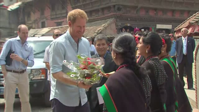 exterior shots nepalese local girls known 'pancha kanya' - the five virgins in national dress presenting hrh prince harry with flowers during his... - nepal stock videos & royalty-free footage