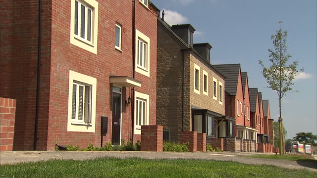 exterior shots new housing development site still under construction with 'help to buy scheme' signage. on may 18, 2014 in ebbsfleet, united kingdom. - housing development stock videos & royalty-free footage