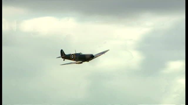 Exterior shots newly restored Supermarine Spitfire Mark I N3200 flying over the Imperial War Museum Duxford on July 09 2015 in Duxford England