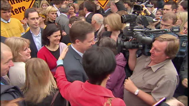 Exterior shots Nick Clegg and wife Miriam surrounded with supporters as they campaign in Glastonbury Somerset