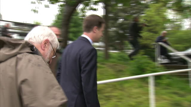 exterior shots nick clegg deputy prime minister at polling station with local liberal democrat councillor david baker on may 22 2014 in sheffield... - british liberal democratic party stock videos and b-roll footage