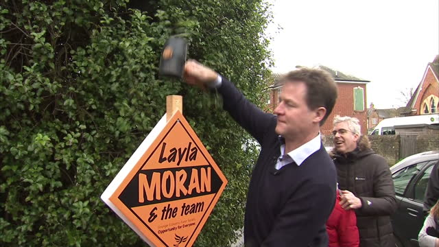 exterior shots nick clegg liberal democrat leader hammers in 300th lib dem stake board in front of media and photographers on march 29 2015 in... - ニック クレッグ点の映像素材/bロール